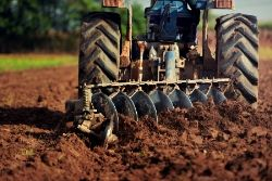 Tractor plowing a field